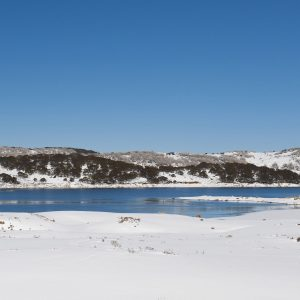 Falls Creek Rocky Valley dam covered in snow, on a beautiful winters day.
