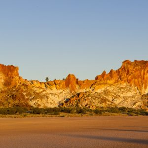 Coloured rocks highlighted by sunset at Rainbow.